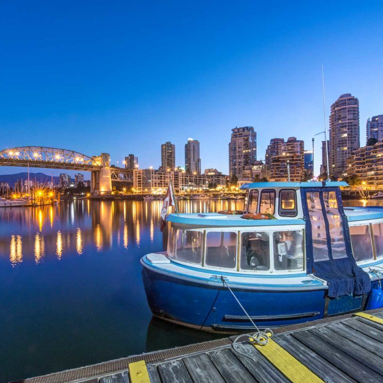 54719 waterfront skyline and harbor illuminated at Borders Immigration Law Firm