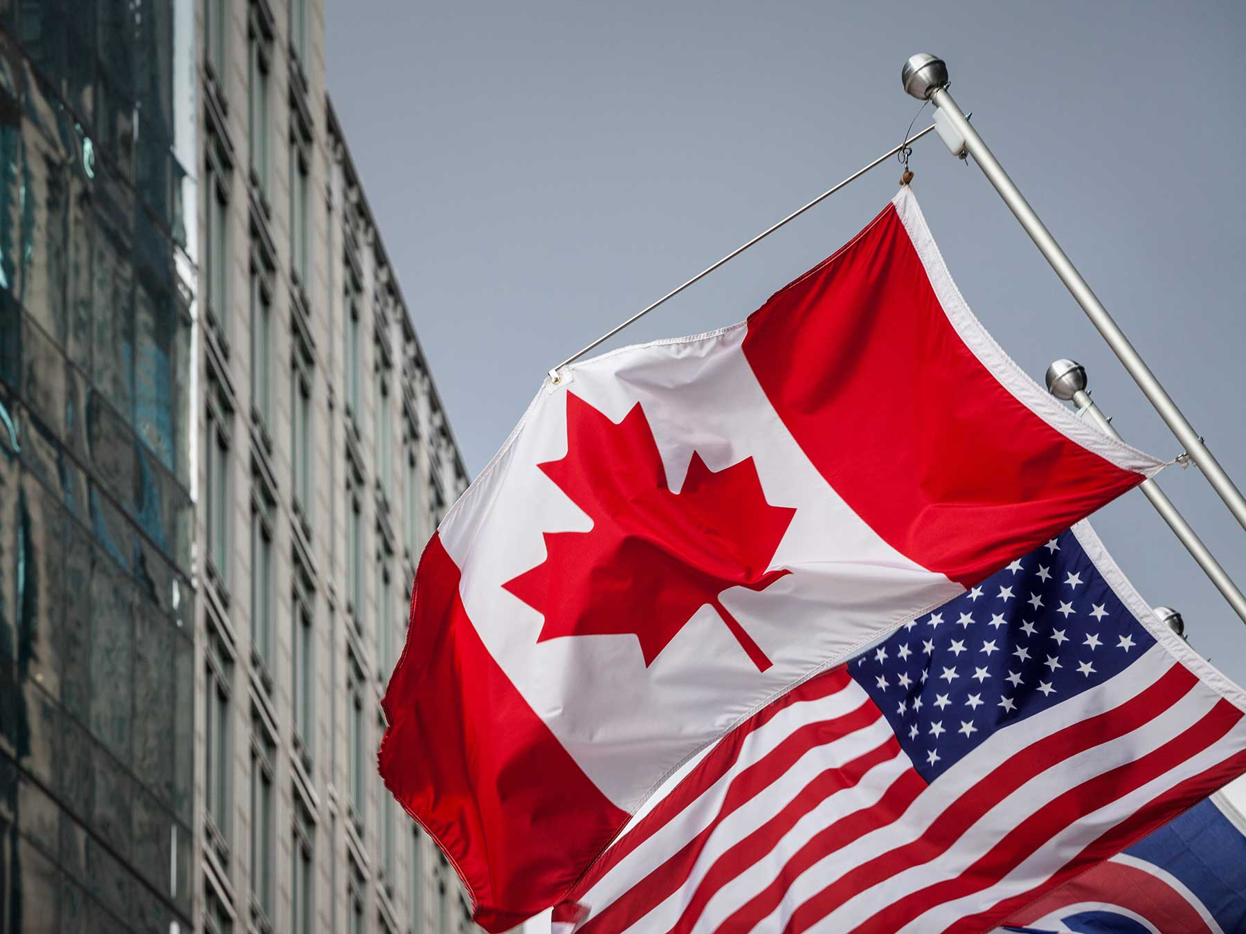 Canada and US Flags Canadian Immigration Lawyers
