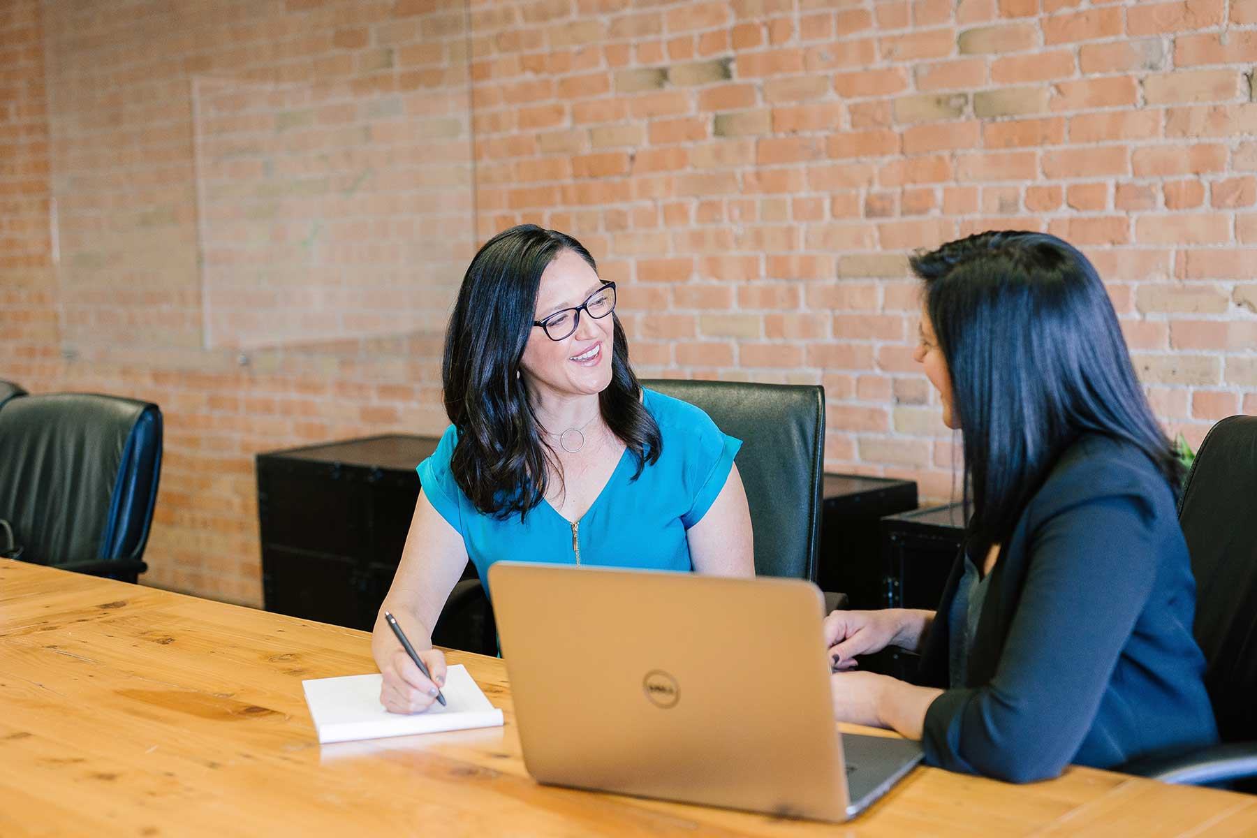 Canadian Immigration lawyer working with client in office