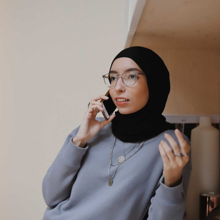 New resident to Canada talking on phone