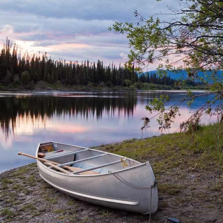 sunset sky and canoe at teslin river yukon canada Borders Immigration Law Firm
